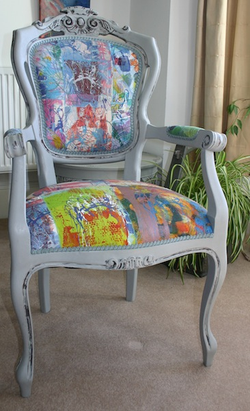 carver chair with embroidered panel